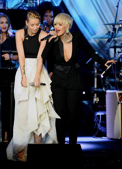 Rita Ora and Iggy Azalea performing