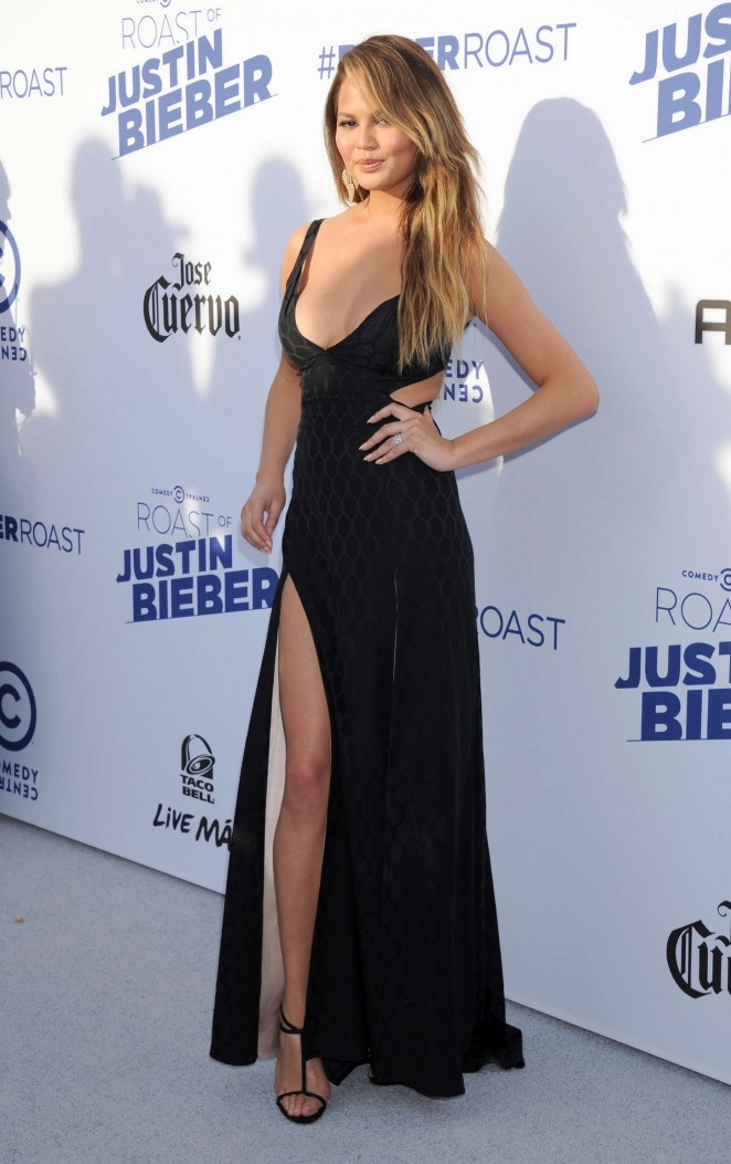 Chrissy-Teigen-in-Temperley-London-at-The-Comedy-Central-Roast-of-Justin-Bieber