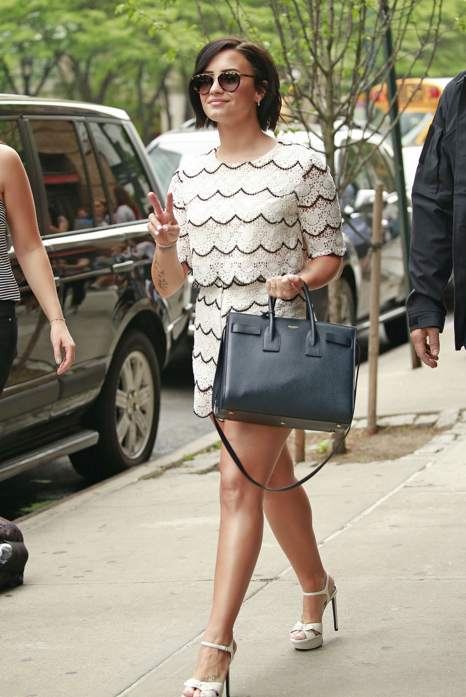 Demi Lovato waves the peace sign while on a stroll in New York City