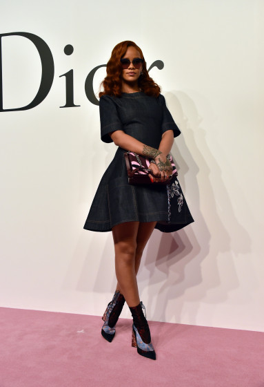 Rihanna-attends-Dior-Fall-2015-Tokyo-Show-wearing-Custom-Dior-Denim-Dress-and-Dior-Resort-2016-Lace-Up-Boots