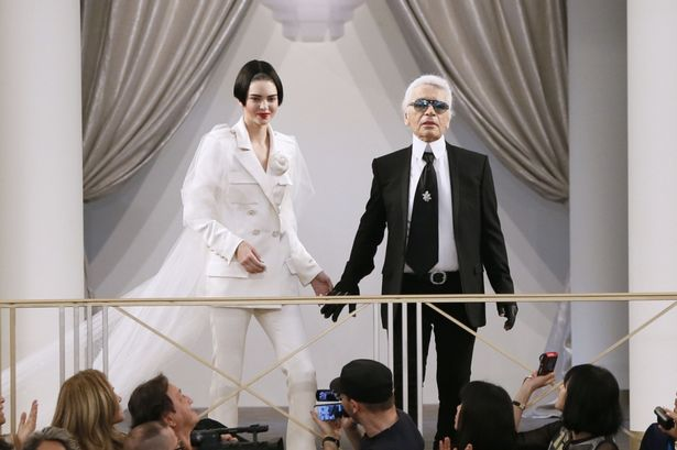 Kendall-Jenner-presents-a-creation-by-German-designer-Karl-Lagerfeld-as-part-of-his-Haute-Couture-Fall-Winter-20152016-1