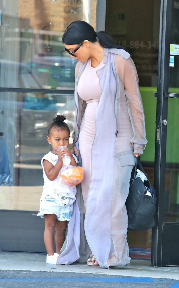 Pregnant- Kim -Kardashian -heads -to -a -birthday- party -with- daughter North- and- niece- Penelope- Disick