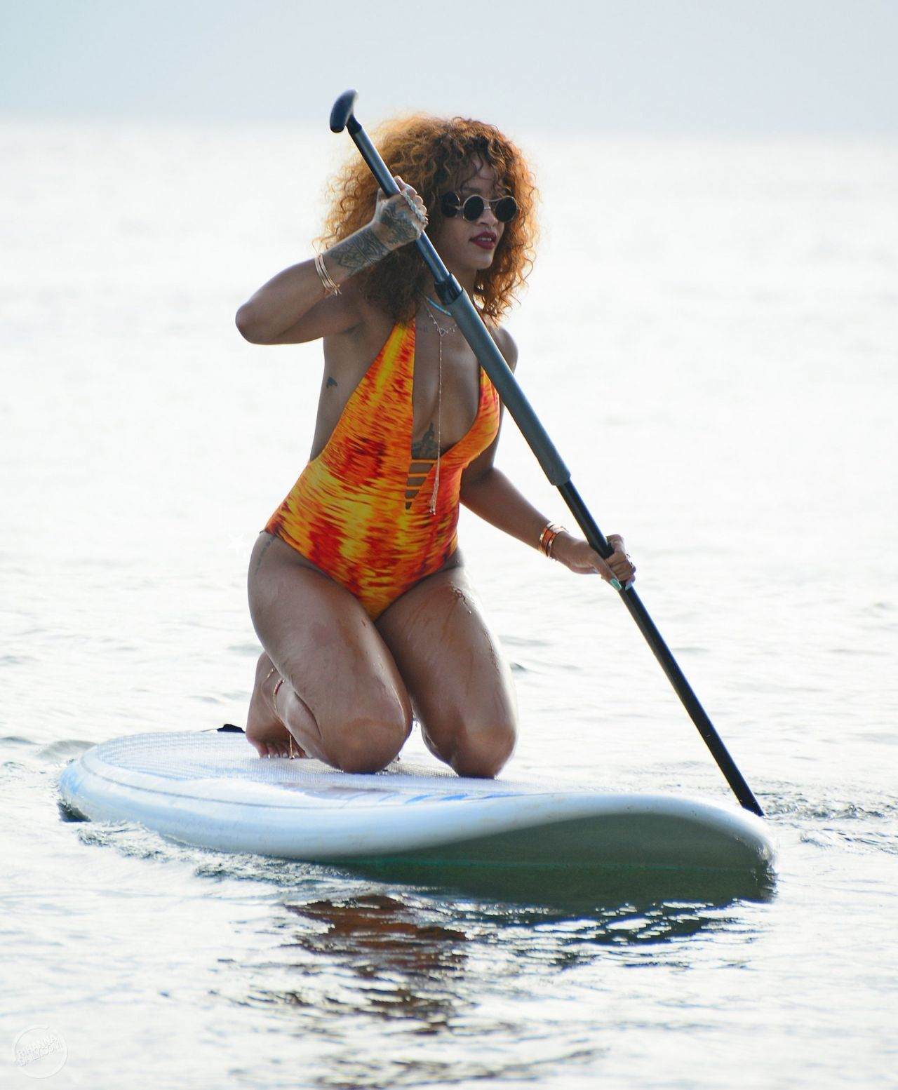 rihanna-paddle-boating-in-a-swimsuit-in-barbados-august-2015_1