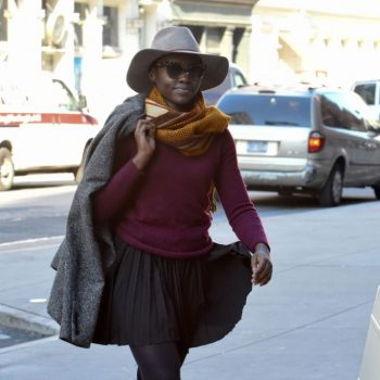 lupita-nuong-o-in-mini-pleated-dress-and-purple-top-at-public-theater-in-nyc-november-2015_1-683×1024