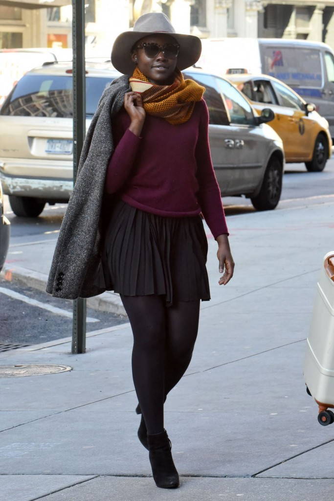 lupita-nuong-o-in-mini-pleated-dress-and-purple-top-at-public-theater-in-nyc-november-2015_3