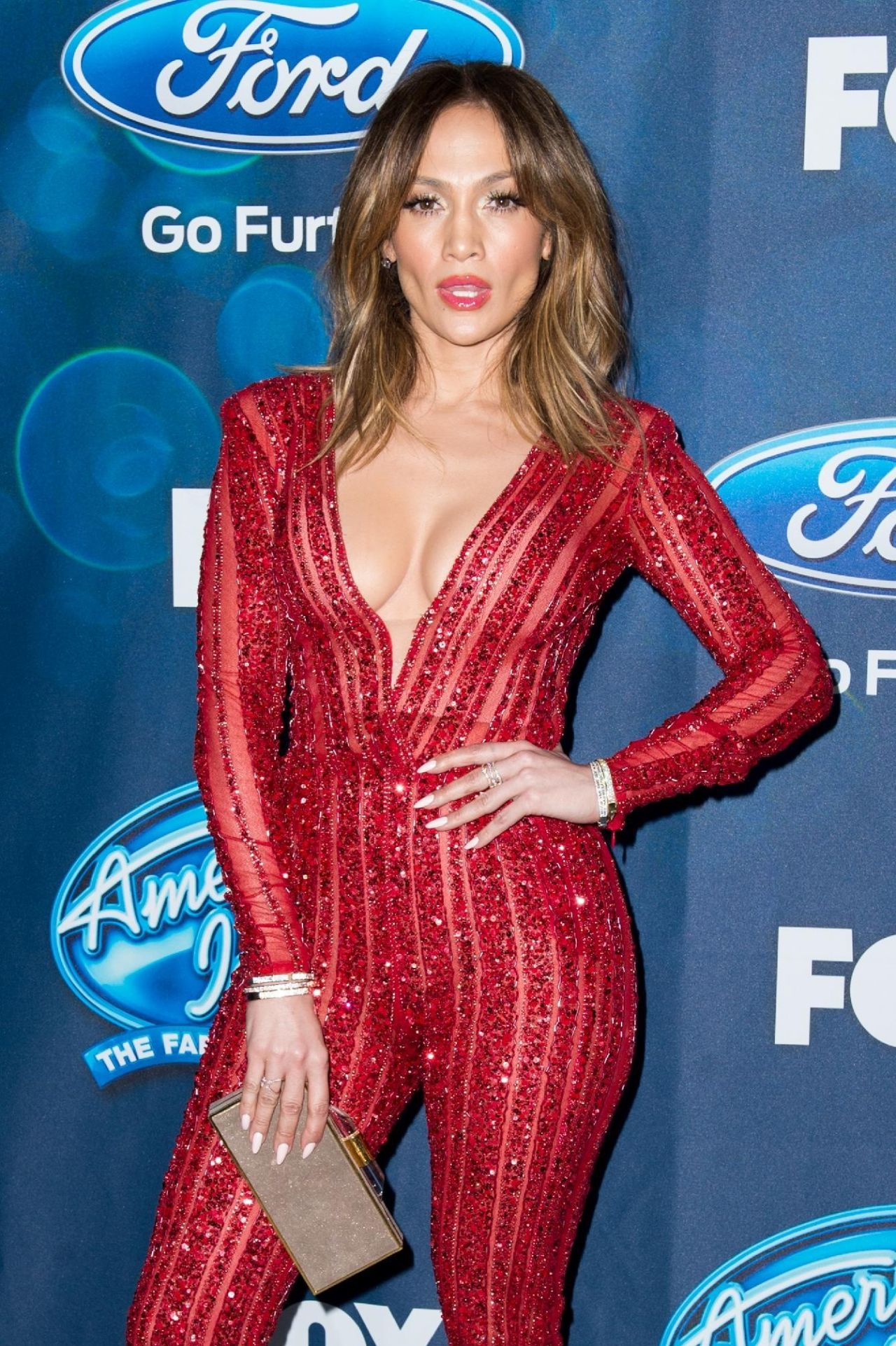 jennifer-lopez-looks-red-hot-in-a-jumpsuit-american-idol-xv-finalists-party-in-west-hollywood-2-25-2016-2