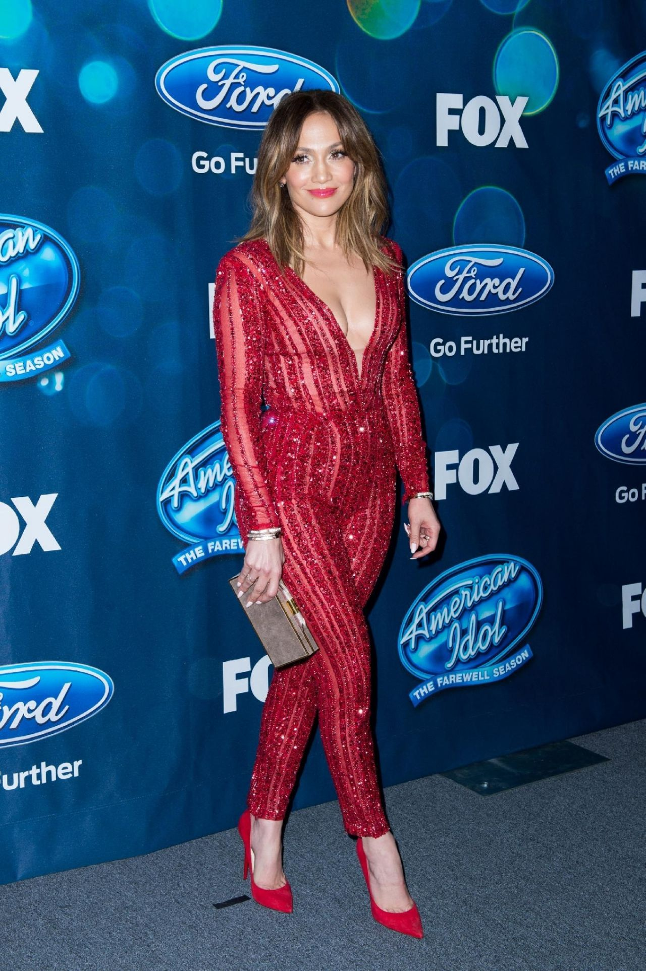 jennifer-lopez-looks-red-hot-in-a-jumpsuit-american-idol-xv-finalists-party-in-west-hollywood-2-25-2016-3