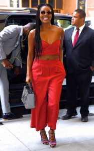 Gabrielle Union in red jumpsuit in New York