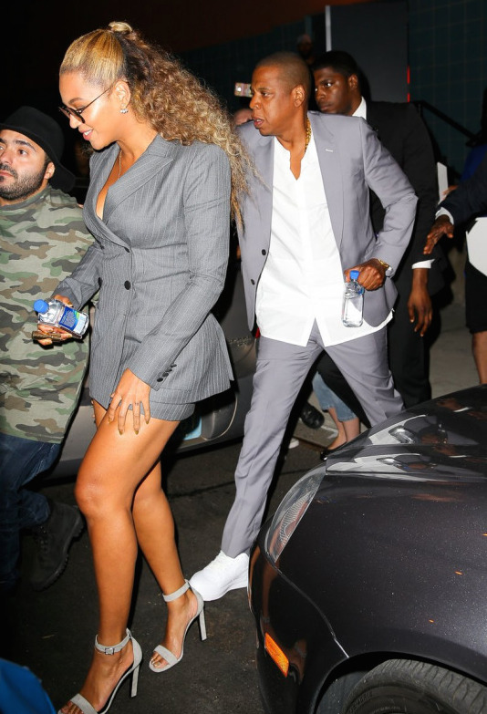 4-Beyonces-Hand-of-Stone-Premiere-Pallas-Gray-Pinstripe-Double-Breasted-Blazer-Worsted-Miniskirt-and-Saint-Laurent-Gray-Sandals-