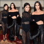 Kim and Kourtney Kardashian  in   black outfits at Paris Fashion Week
