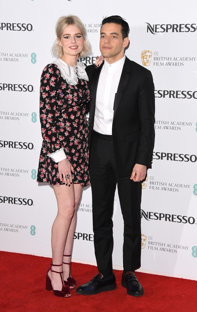 lucy-boynton-in-miu-miu-and-rami-malek-in-berluti-the-nespresso-british-academy-film-awards-nominees-party