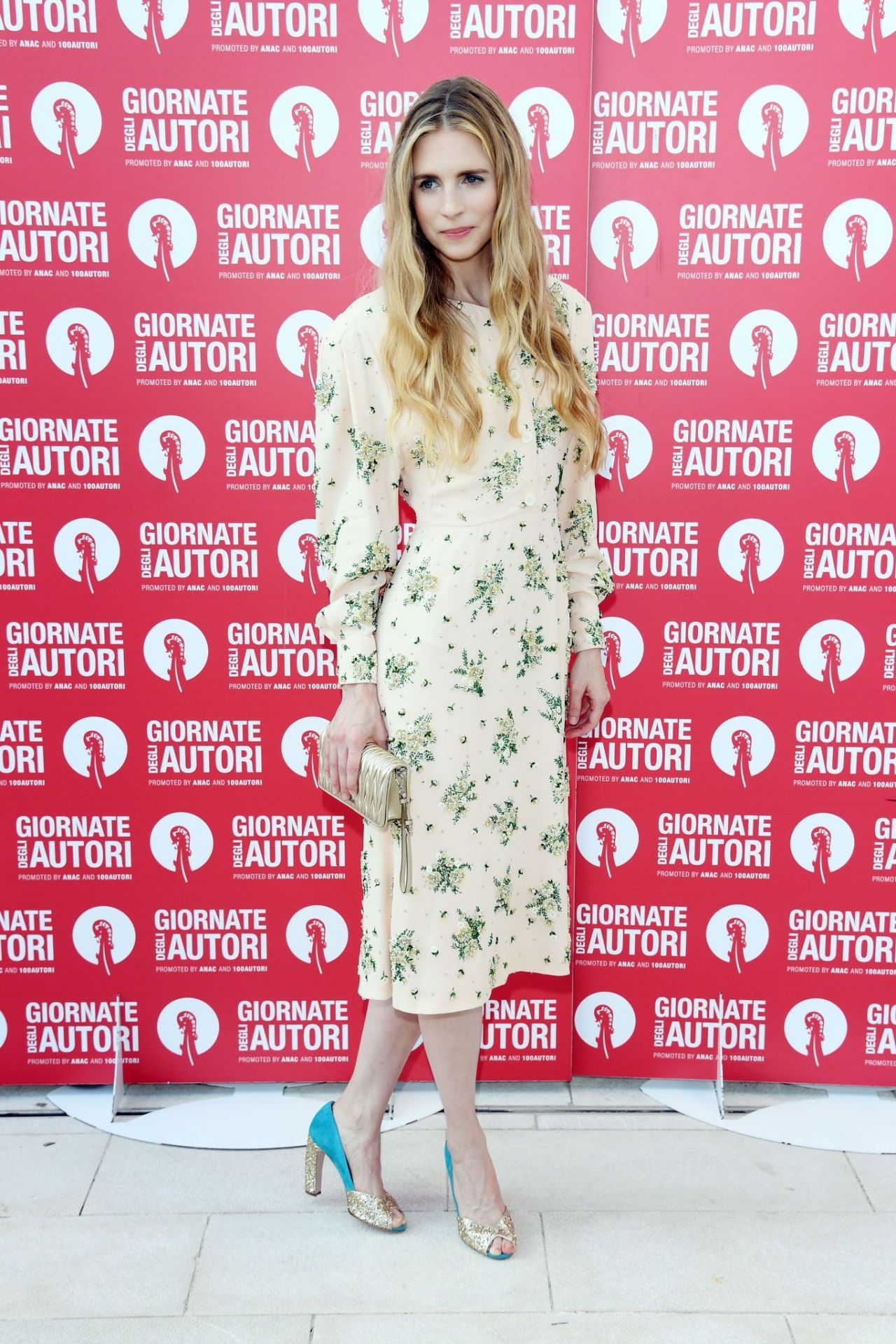 brit-marling-in-miu-miu-@-miu-miu-venice-film-festival-photocall-in-venice