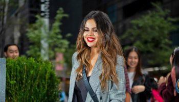 selena-gomez-in-checkered-frame-suit-arriving-to-iheart-radio-in-new-york