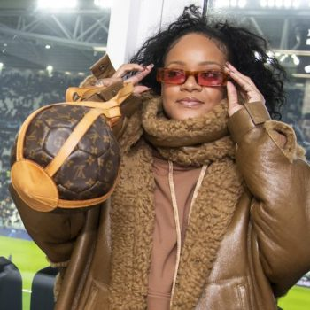 rihanna-rocked-a-fenty-coat-louis-vuitton-purse-italian-soccer-game