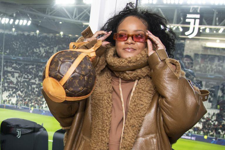 rihanna-rocked-a-fenty-coat-louis-vuitton-purse-italian-soccer-game