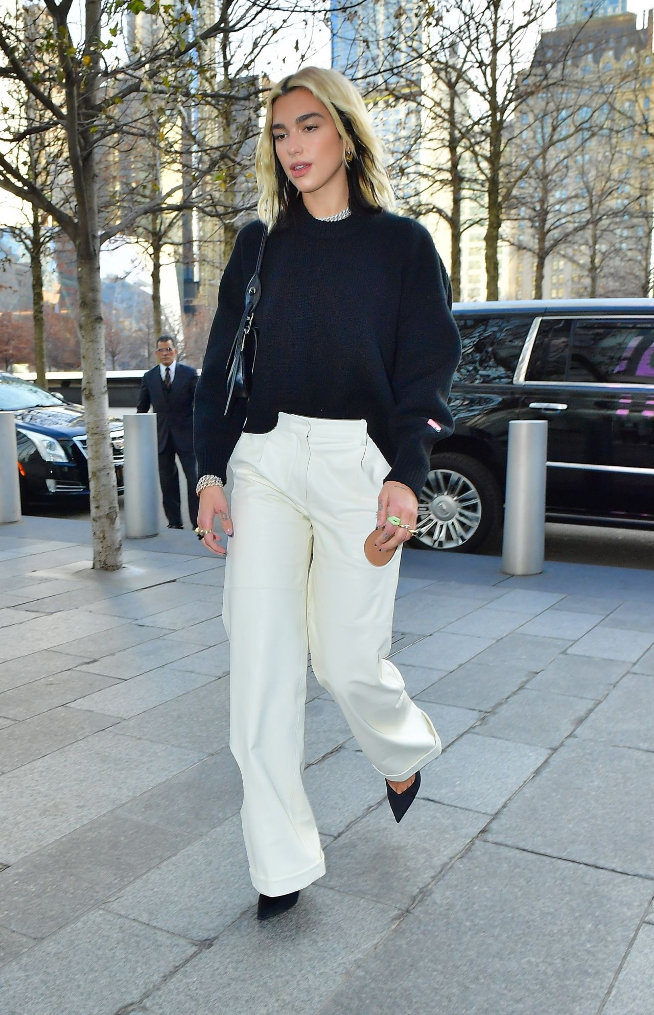 dua-lipa-in-off-white-trousers-out-in-new-york