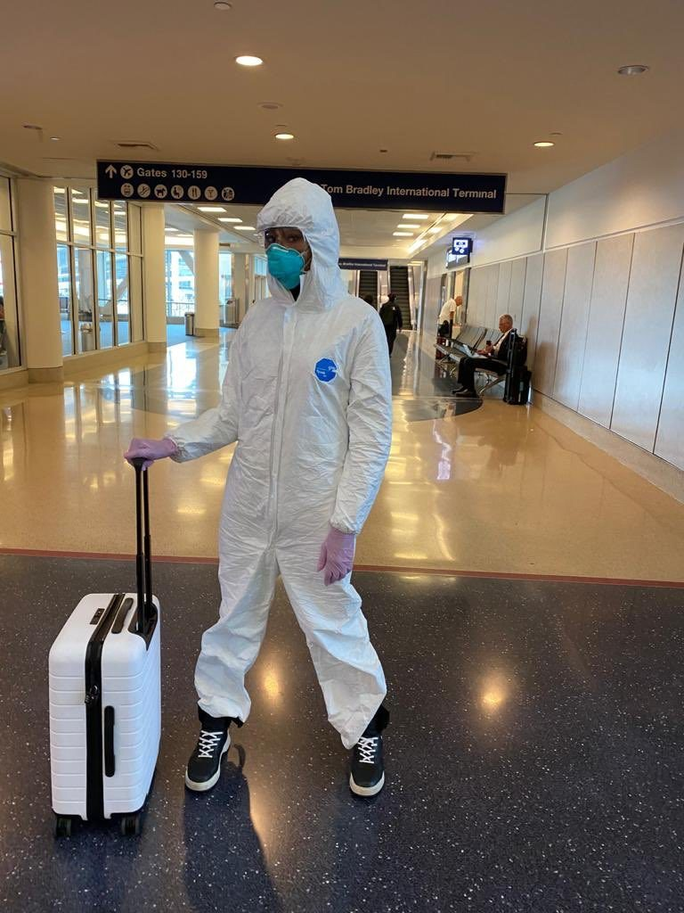 super-model-naomi-campbell-wears-hazmat-suit-face-mask-gloves-during-flight