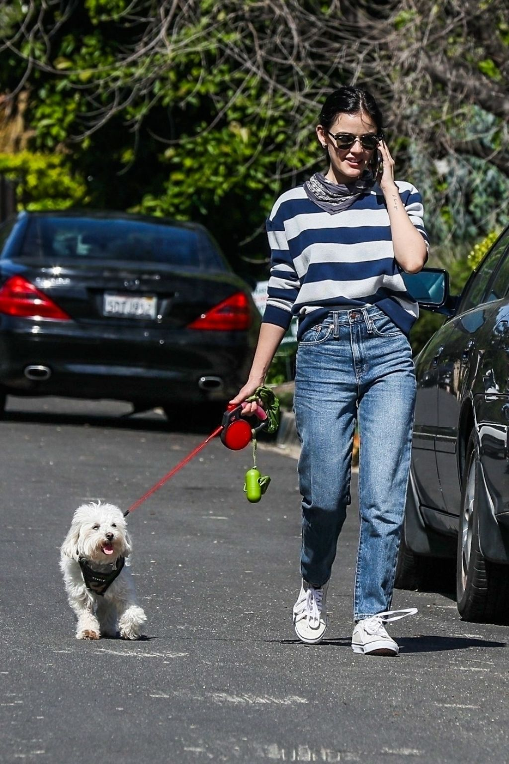 lucy-hale-in-stripe-top-walking-her-dog-in-studio-city