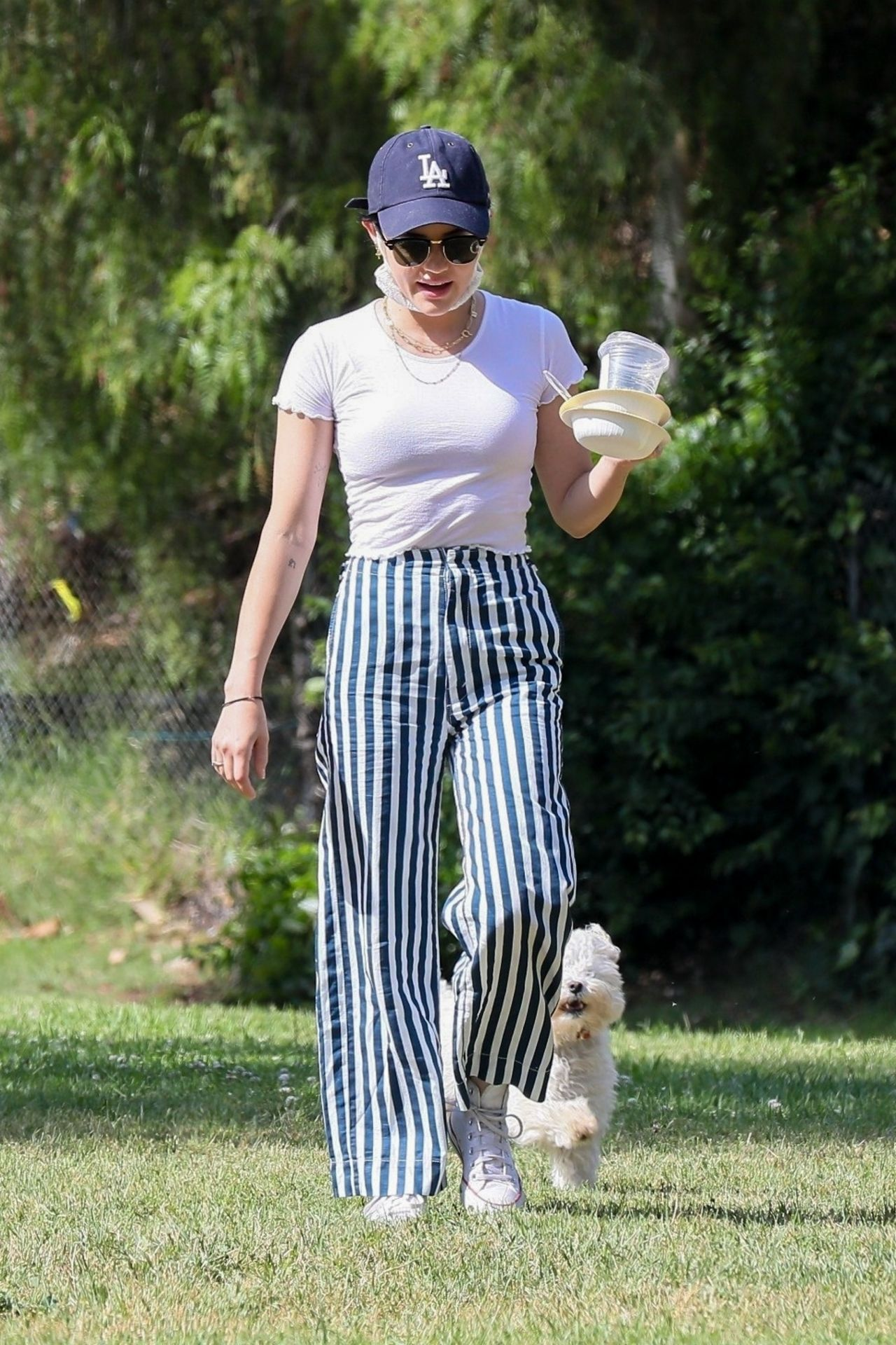 lucy-hale-walking-her-dog-in-the-park-in-los-angeles-05-16-2020