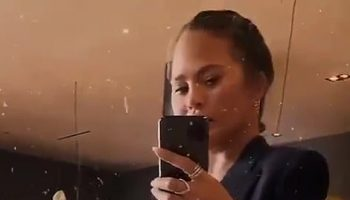 chrissy-teigen-shows-her-baby-bump-on-full-display-in-new-video
