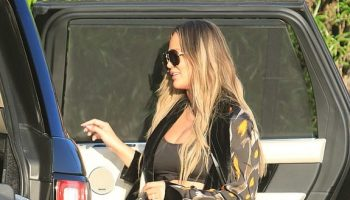 chrissy-teigen-in-leopard-print-duster-cardigan-bristol-farms-in-california