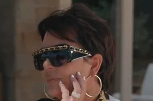 kris-jenner-wearing-versace-tribute-print-silk-wrap-dress