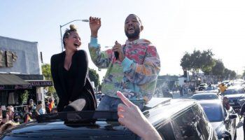chrissy-teigen-john-legend-joining-a-street-celebration-after-biden-harris