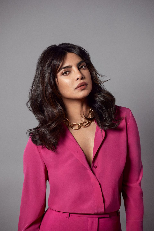 priyanka-chopra-jonas-wearing-st-john-hot-pink-suit-promoting-her-hair-care-line