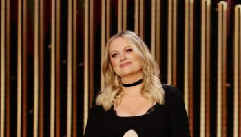 amy-poehler-in-black-dress-hostiing-the-2021-golden-globe-awards