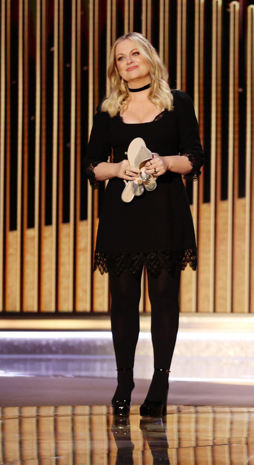 amy-poehler-in-black-dress-hostiing-the-2021-golden-globe-awards