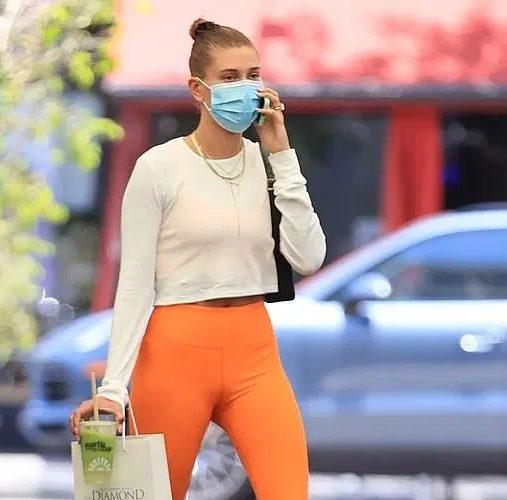 hailey-bieber-wore-orange-leggings-out-in-los-angeles-june-16-2021