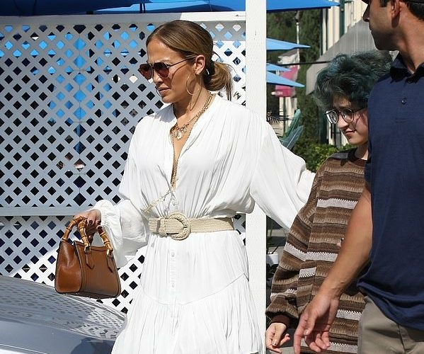 jennifer-lopez-wears-white-a-l-c-dress-with-boots-sunset-plaza-august-25-2021