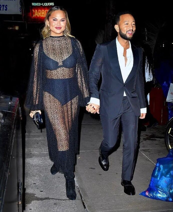 chrissy-teigen-wears-sheer-black-lace-dress-for-dinner-after-2021-tony-awards