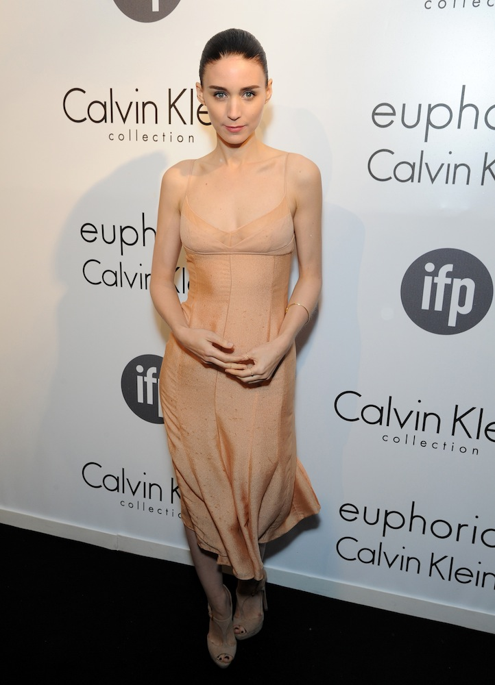Rooney Mara in a nude Calvin Klein slip dress paired with matching sandals