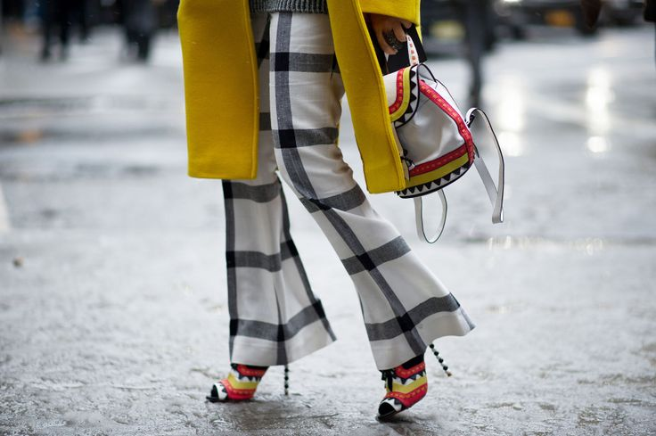 Black and white stripped Flared pants with yellow coat