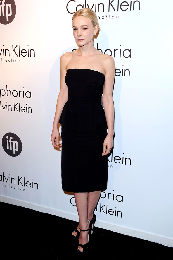 Carey Mulligan in a strapless Calvin Klein black dress with black Brian Atwood ankle-strap sandals .