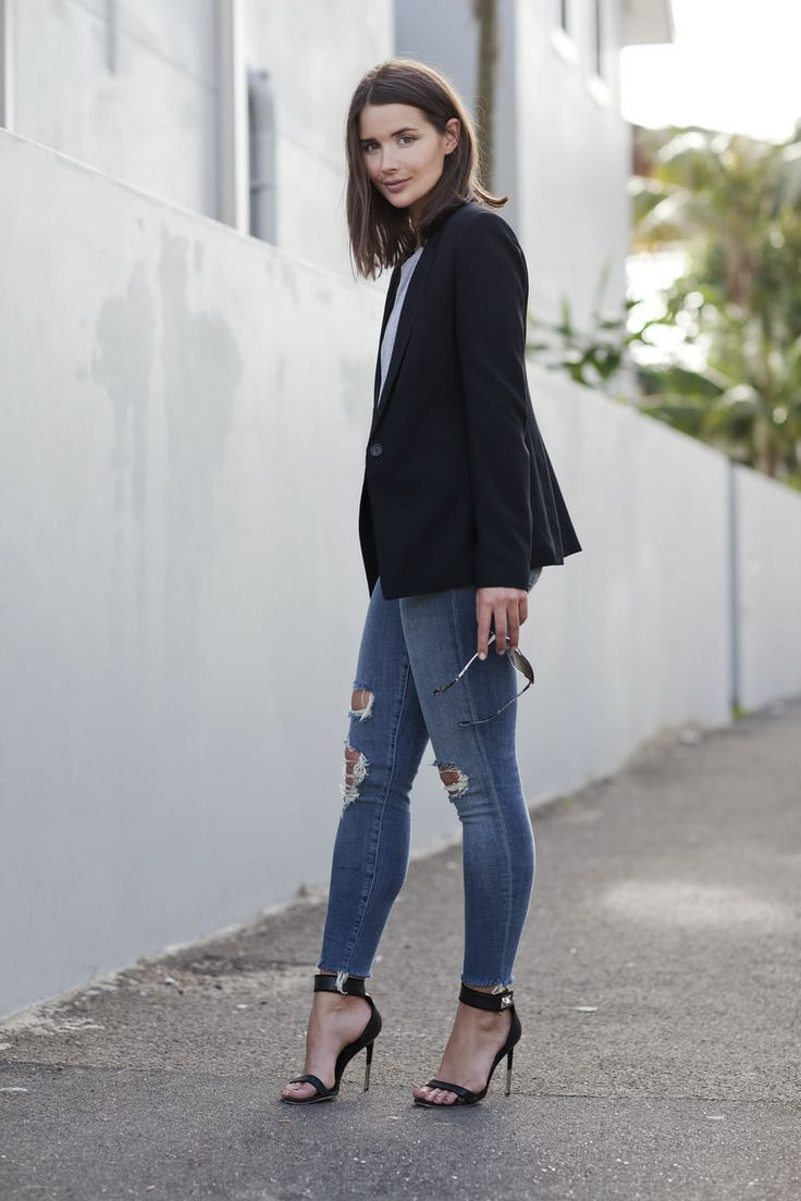 Add a dark jacket over a blouse with your jeans to look chic and sophisticated