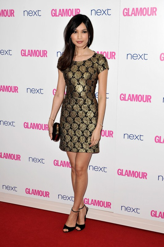 Gemma Chan was gilded in a black and gold jacquard mini dress