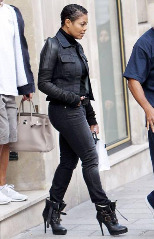 Janet Jackson in a levis4 jeans and a black jacket