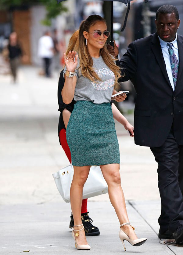 Jennifer Lopez rocking a blouse with Lips imprinted on it with a green skirt in New York 06/19/2014