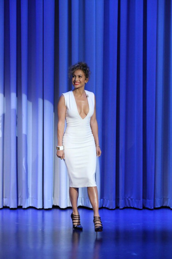 Jennifer Lopez, rocking a white v cut bodycon Solace London dress, on 'The Tonight Show with Jimmy Fallon' in NYC, June 16, 2014 (Courtesy of NBC)