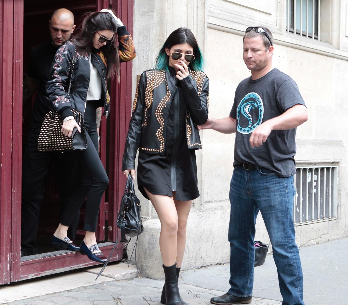 Kendall and kylie Jenner leaving Kanye West Paris apartment