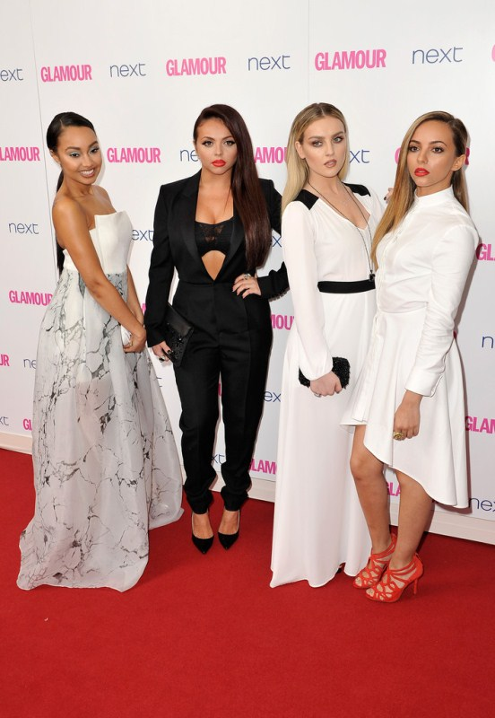 The Little Mix ladies at The Glamour Awards Leigh-Anne is in a strapless printed gown; Lesy is in a menswear-inspired $2,913 Saint Laurent Tuxedo Jumpsuit, $9 American Apparel Stretch Floral Lace Tube Bra, and a $60 Zara Diamante Leather Clutch; Perrie is in a $231 Donna Mizani Frost Side Tie Tuxedo Gown and a $100 Zara Beaded Box Clutch; and Jade is in a $916 Alexander McQueen Cotton Piqué Dress and $119 Zara Red Strappy High Heel Sandals. j