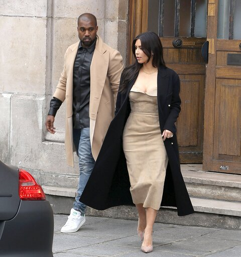 Kim and Kanye shopping leaving Maison Martin Margiela showroom in Paris.