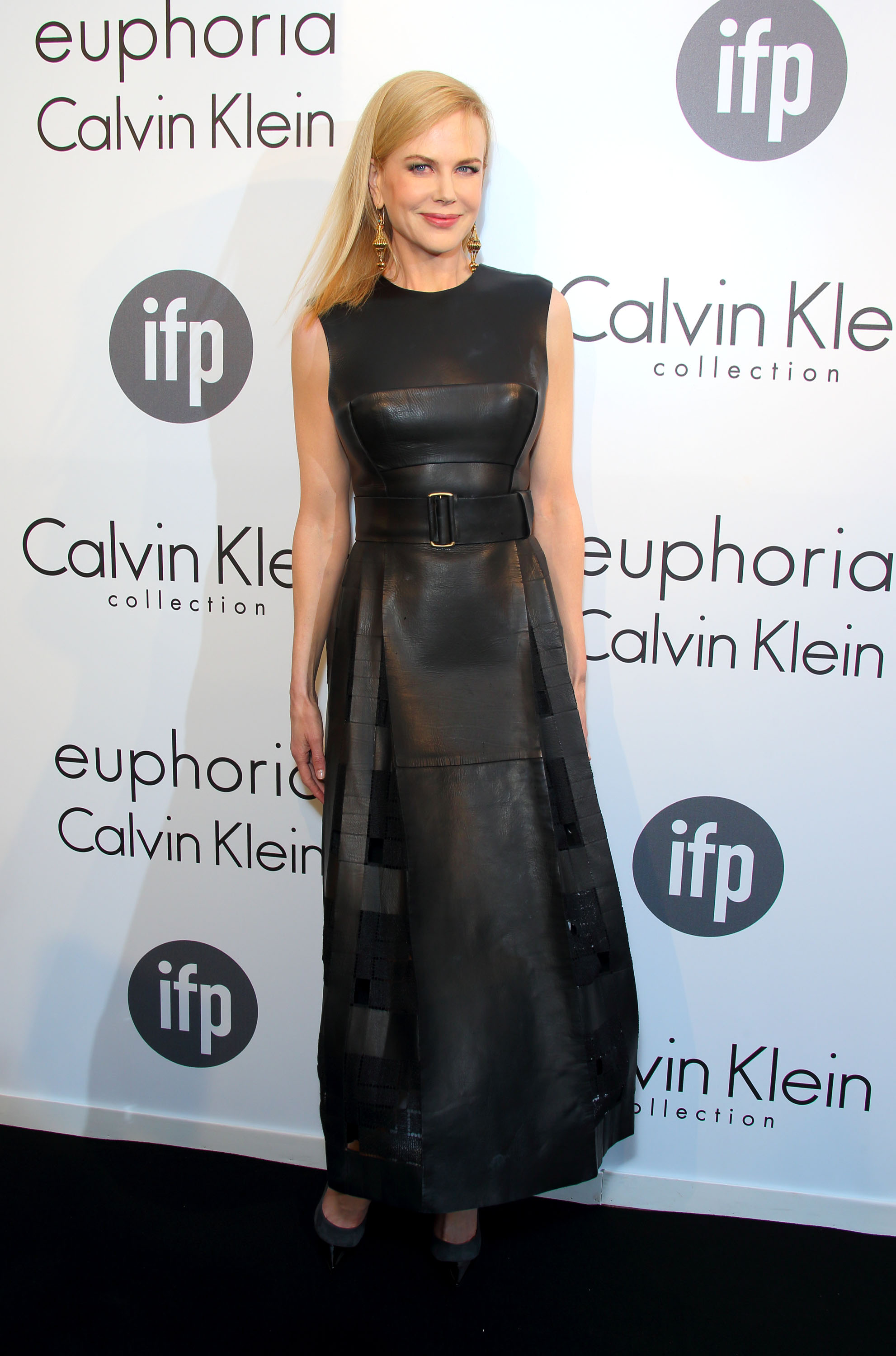 Nicole Kidman in a Calvin Klein sleeveless ankle-length belted leather dress from the Fall 2013 collection, paired with black Jimmy Choo ankle-strap pumps and . drop earrings by Fred Leighton.